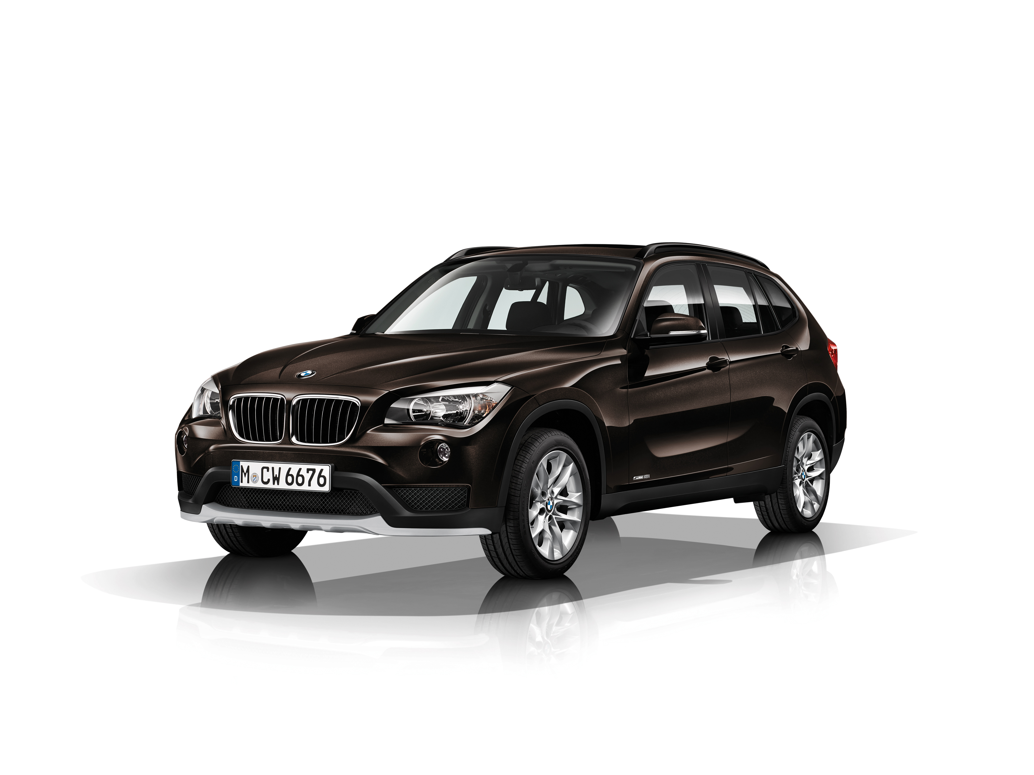 bmw x1 styling refreshes and tech upgrades for 2014 bimmerfile. Black Bedroom Furniture Sets. Home Design Ideas